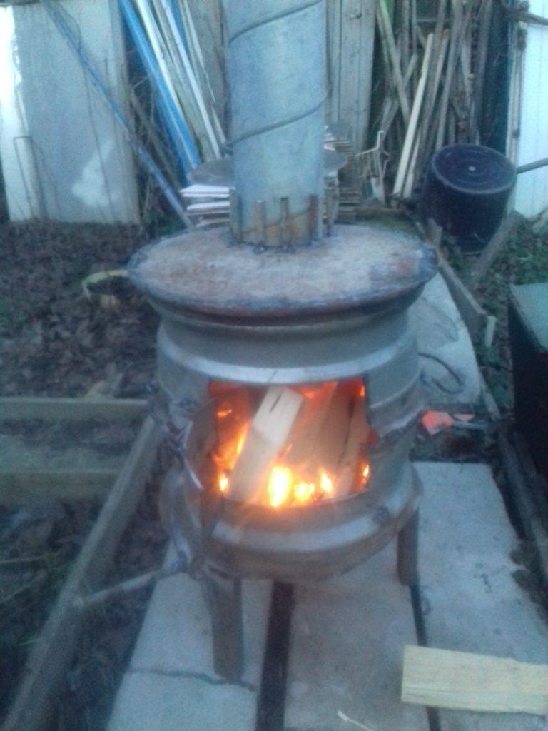 печь в гараж, теплицу из двух дисков